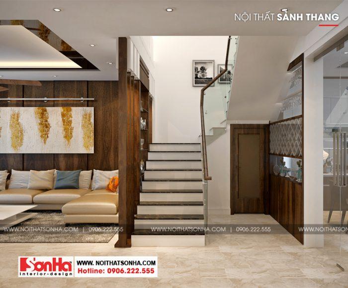 Còn đây là thiết kế sảnh thang tầng 1 giữa phòng khách và phòng bếp ăn