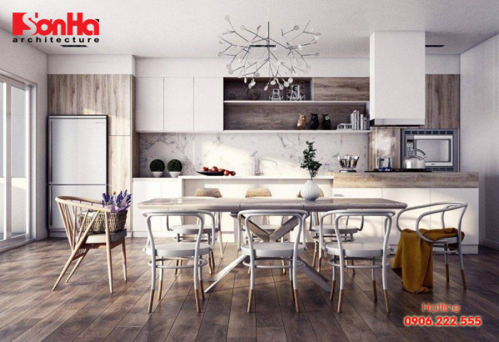 Tủ bếp chữ L và bộ bàn ghế ăn xinh xắn làm nên không gian bếp đẹp