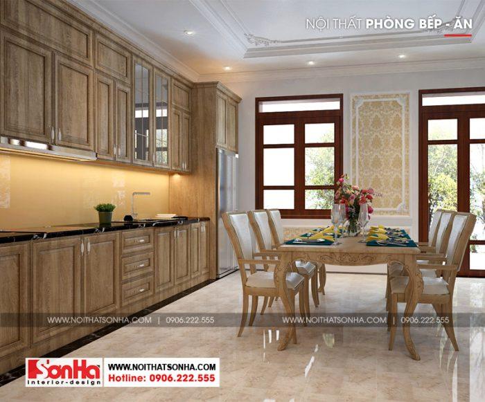 Không gian bếp ăn bố trí gọn gàng với tủ bếp và bộ bàn ăn gỗ đẹp mắt