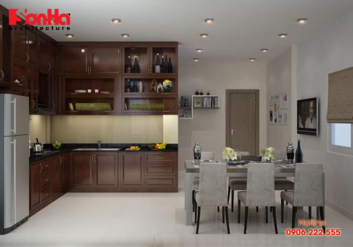 Chiếc tủ bếp chữ L bằng gỗ xinh xắn kết hợp hài hòa với nội thất khác