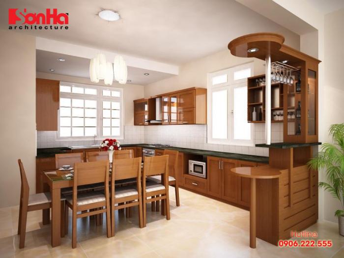 Gỗ xoan đào màu trầm làm nên nét đẹp và chiều sâu của không gian bếp