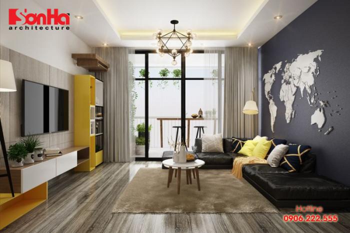Phòng khách được thiết kế với tone màu ghi vàng kết hợp gây ấn tượng