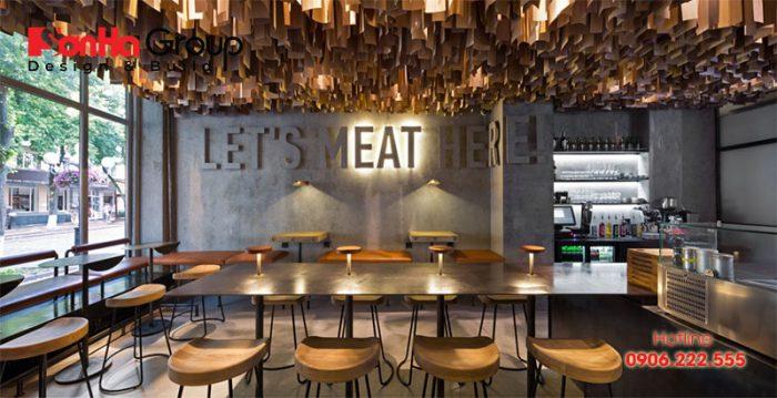 Thiết kế quán ăn đẹp sẽ biết kết hợp sự ấm cúng bằng ánh sáng vàng của đèn