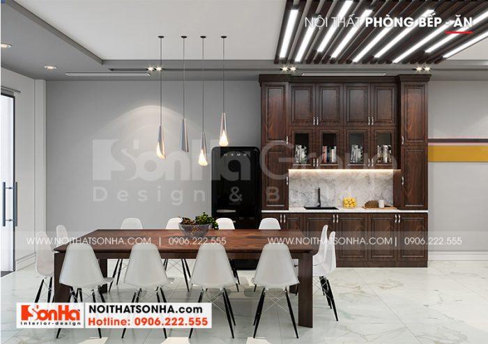 Bộ bàn ăn đẹp được kết hợp tủ bếp gỗ trong không gian phòng bếp hiện đại, ấm cúng