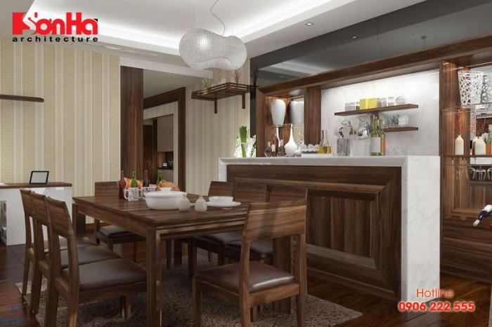 Không gian bếp đẹp với nội thất gỗ óc chó khá sang trọng và ấm cúng