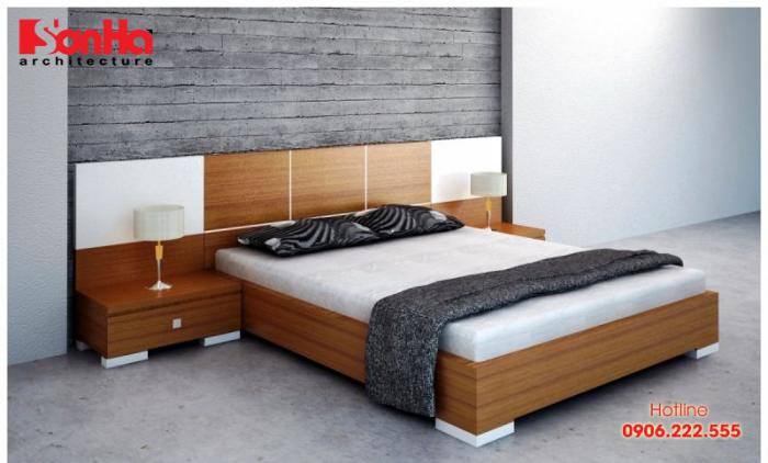 Phòng ngủ được bố trí đơn giản với giường ngủ bằng gỗ công nghiệp