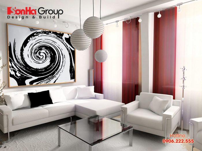 Việc treo tranh phù hợp sẽ góp phần làm sáng bừng không gian phòng khách